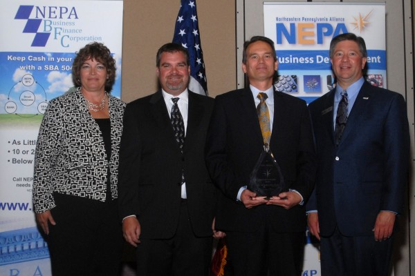 From left: Mary Beth Wood, NEPA Board Chairperson; Brandon Igdalsky, Pocono Raceway; Mike Bean accepting the Regional Leadership Award on behalf of Mohegan Sun Pocono and Jeffrey Box, President & CEO, NEPA Alliance. Photo courtesy of NEPA Alliance.