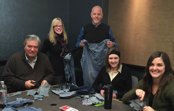 To kick off their casual Friday policy in 2016, Riger Marketing Communications employees cut patterns into donated jeans for Sole Hope, an organization that uses jeans to make closed-toed shoes for impoverished African children.
