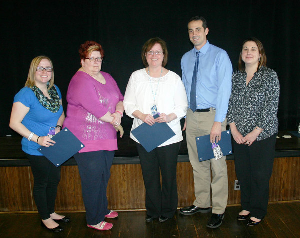 Among the employees honored for one year of service were, from left, Elizabeth Tuturice, residence life coordinator; Karen Lightcap, Practical Nursing program coordinator; Mary Mehalshick, financial assistant, Housing and Food Services; Mark Tranguch, manager, Housing and Food Services; and Lenore Koval, financial assistant, bursar's office.
