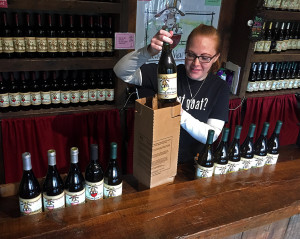 Tasting room staff member Sarah Ruggiero packing the vineyard's first online order Monday.