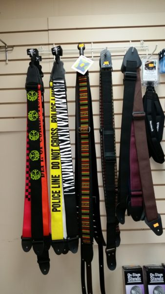 Owner Brendan Fitzpatrick grew up in the restaurant business, where inventories can be held for short periods. He said the advantage of selling musical instruments and accessories, such as these guitar straps, is they are not perishable.